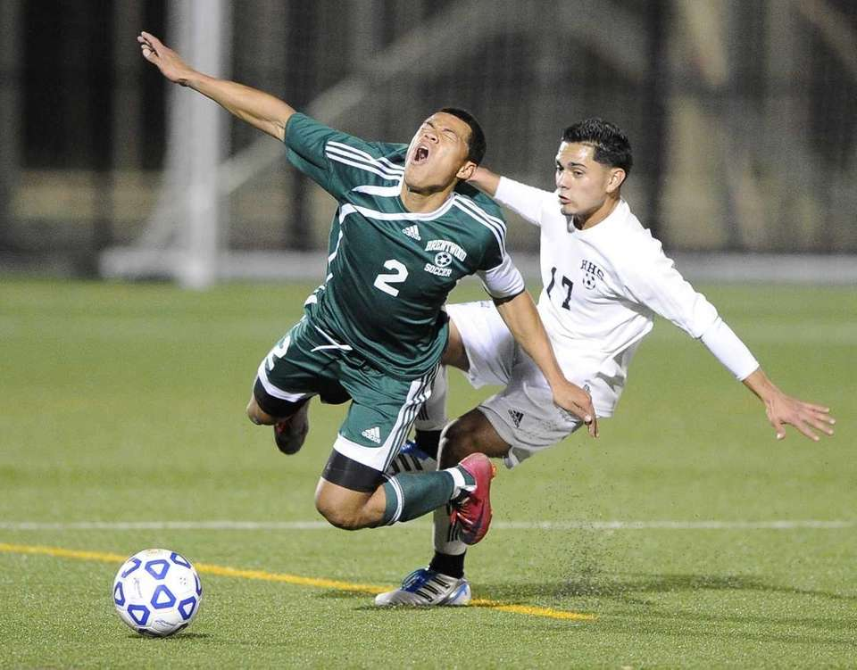 Brentwood's Christian Argueta is tripped by Hicksville's Christian