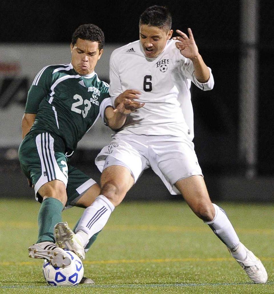 Hicksville's Kyle Poetzsch battles for the ball with