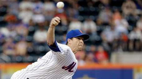 Mets' Jacob deGrom delivers a pitch during the