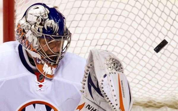 New York Islanders' Evgeni Nabokov, of Kazakhstan, allows