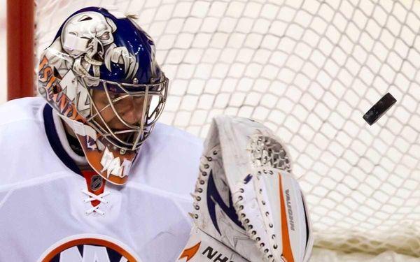 New York Islanders' Evgeni Nabokov, of Kazakhstan, allows