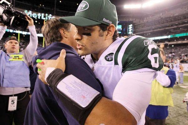 New England Patriots head coach Bill Belichick meets