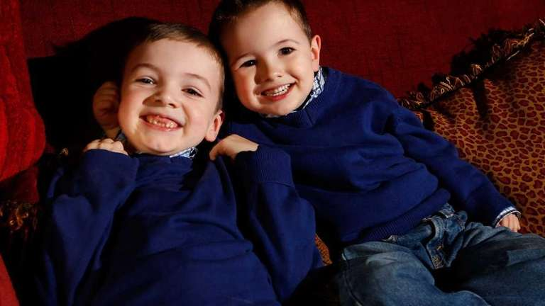 C.J. Booth, 7, left, and his brother, Jake,