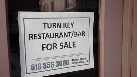 For sale sign outside Bel Posto restaurant in