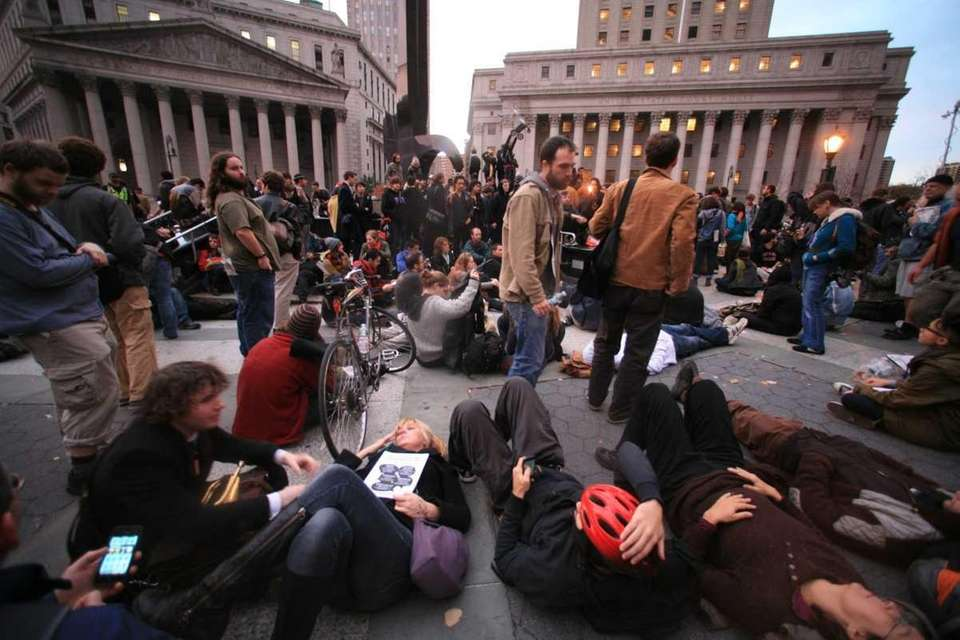 Occupy Wall Street demonstrators congregate in Foley Square