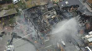 An aerial photo shows firefighters in Fire Island