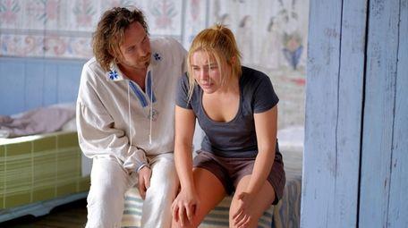 "Vilhelm Blomgren and Florence Pugh in A24's ""Midsommar,"""