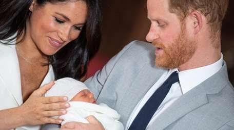 Meghan Markle and Prince Harry with their son,
