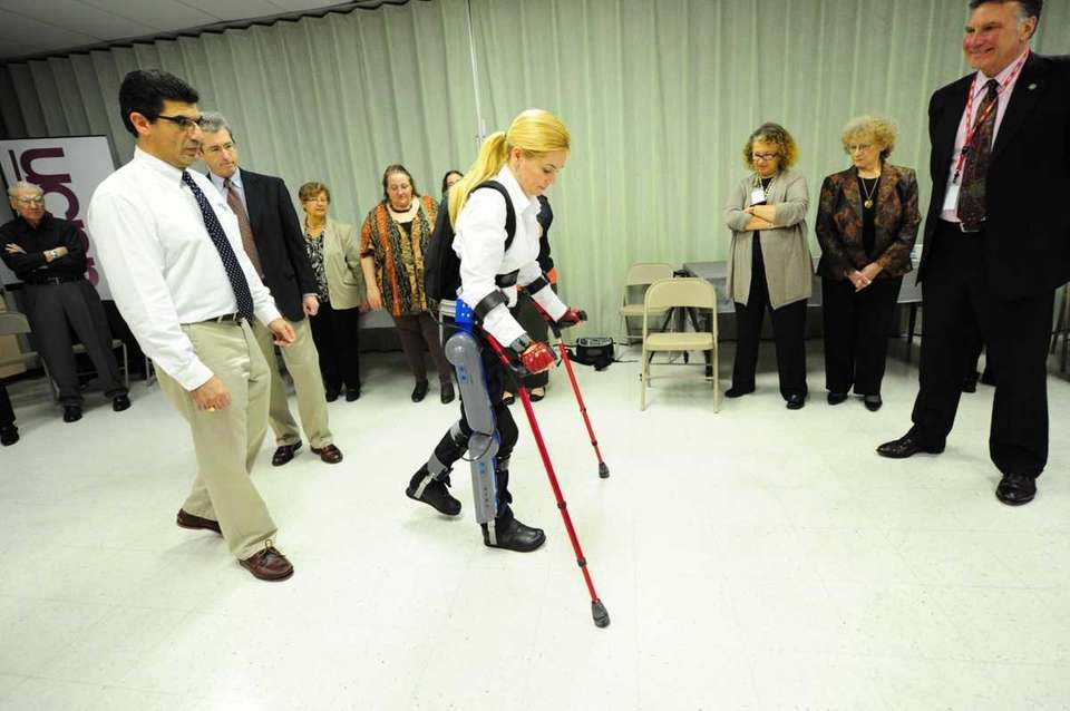 Agnes Fejerdy demonstrates walking with the ReWalk Device