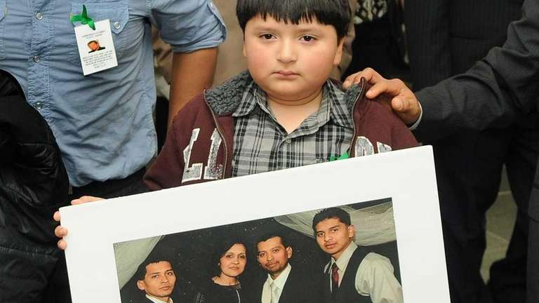 Brandon Caceres, 8, leaves court in Riverhead after