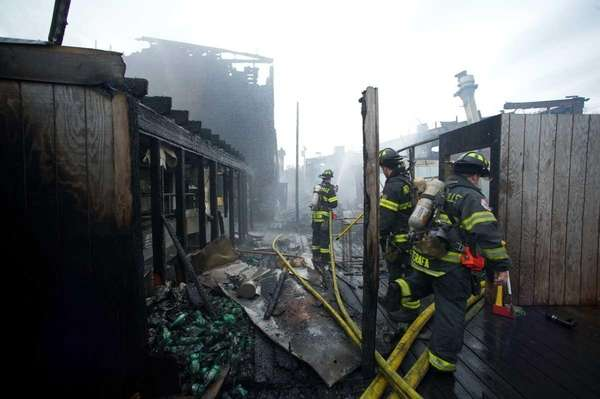 Photo credit: Newsday Daniel Goodrich | The Pavilion complex at the Pines, Fire Island burned Monday night with more than 400 firefighters responding to fight the blaze. (Nov. 15, 2011)