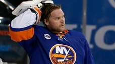 Robin Lehner looks on in the first period