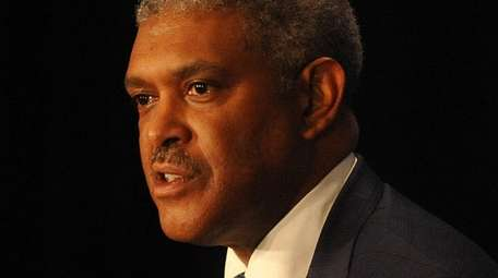 Knicks president Steve Mills speaks with the media