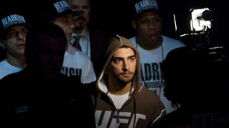 Nick Pace walks to the octagon for his