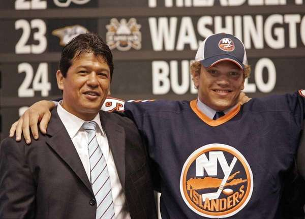 Kyle Okposo, right poses for a photo with