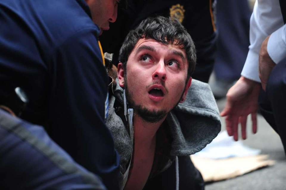 A protester is arrested during the Occupy Wall