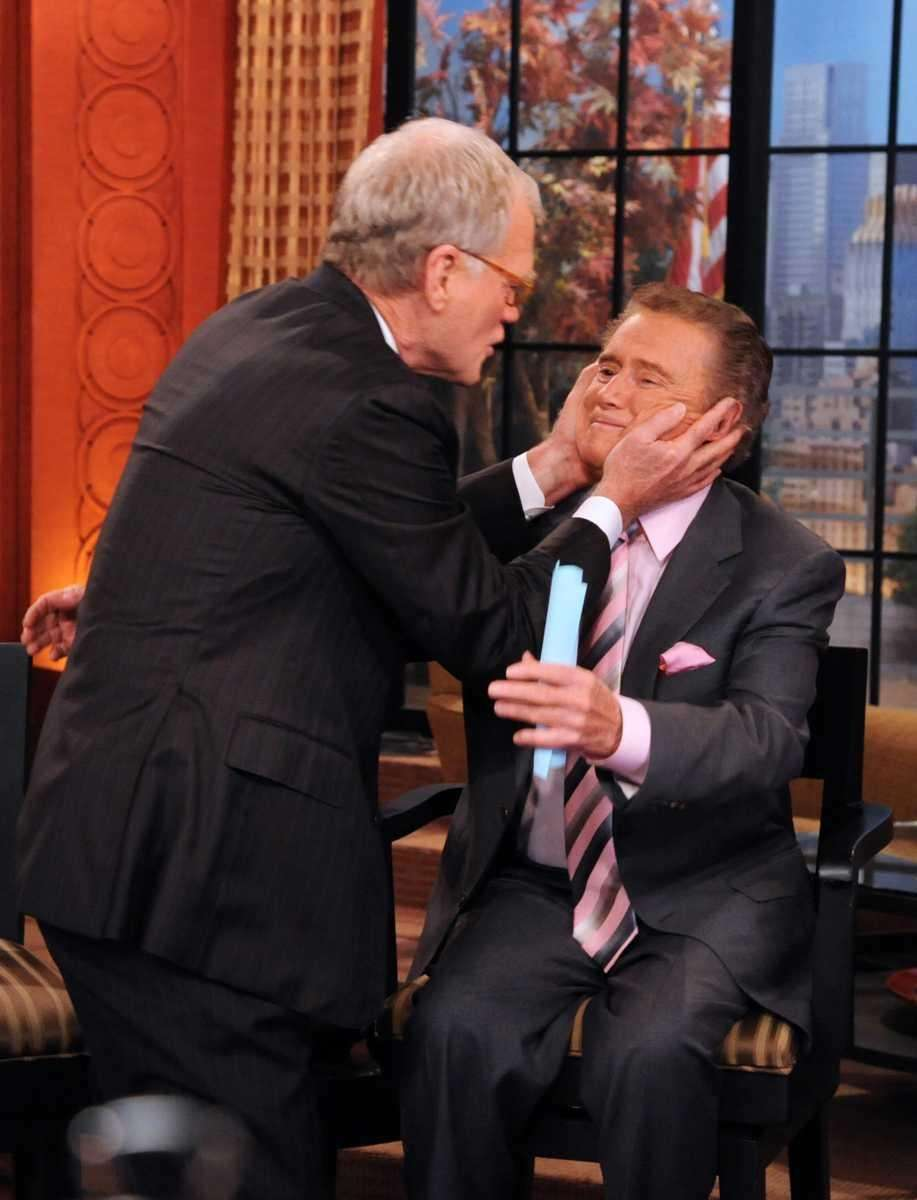 Talk show host Dave Letterman prepares to kiss