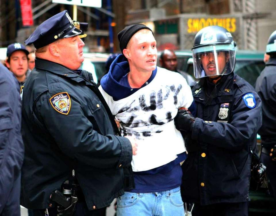 NYPD officers arrest an Occupy Wall Street protester