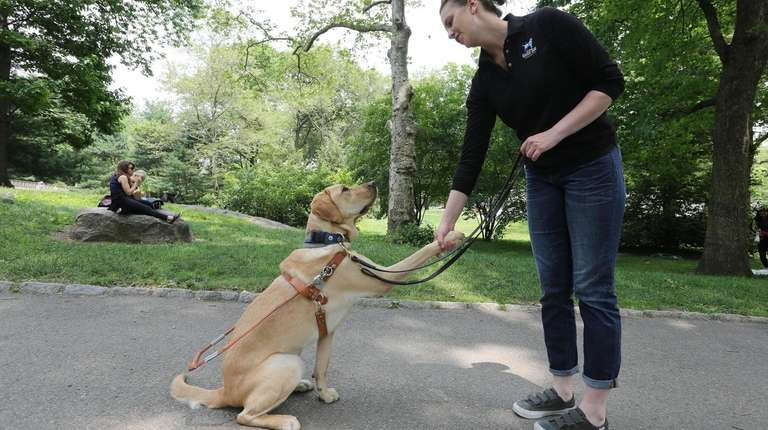 Olivia Poff, a guide dog mobility instuctor, shakes