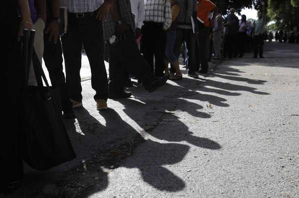 People stand in line for a job fair