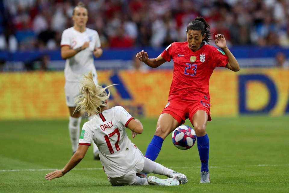 England's Rachel Daly, left, duels for the ball
