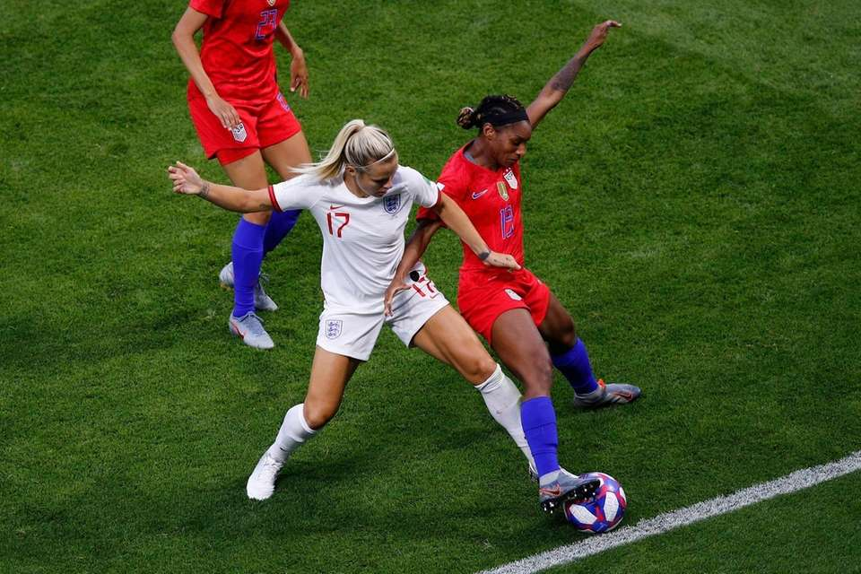 England's Rachel Daly, left, and the United States'