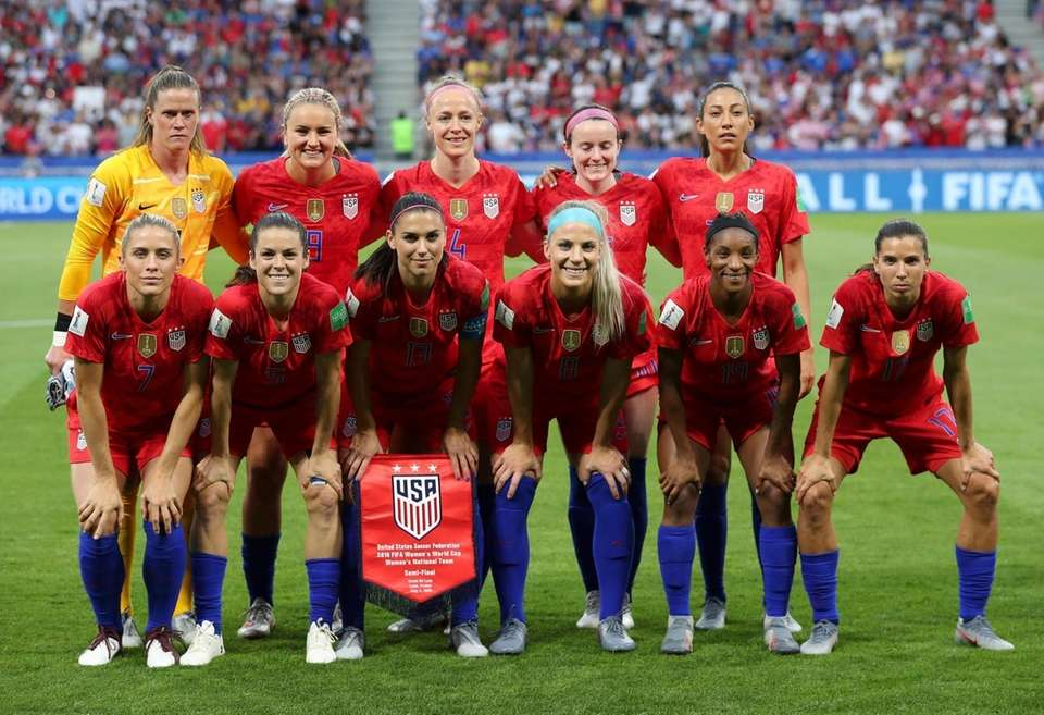 US players pose for the photographers before the