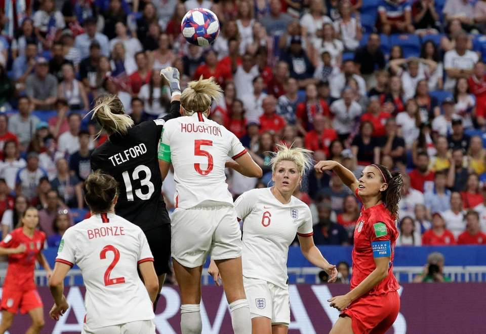 England goalkeeper Carly Telford deflects a ball as