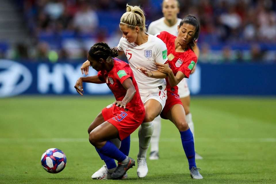 England's Rachel Daly, center, duels for the ball