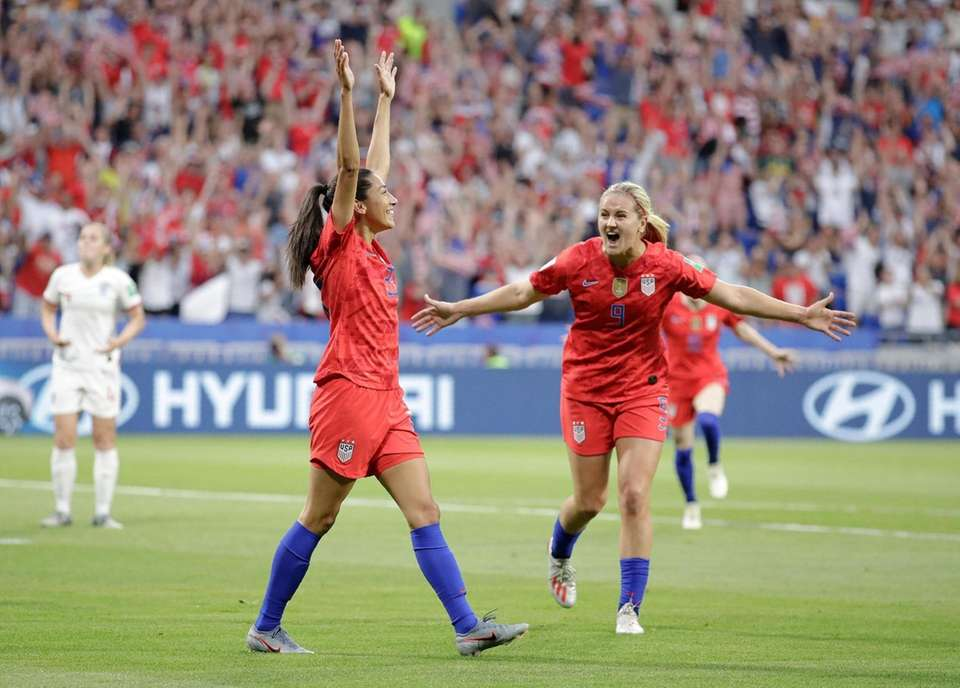 The United States' Christen Press, left, celebrates after