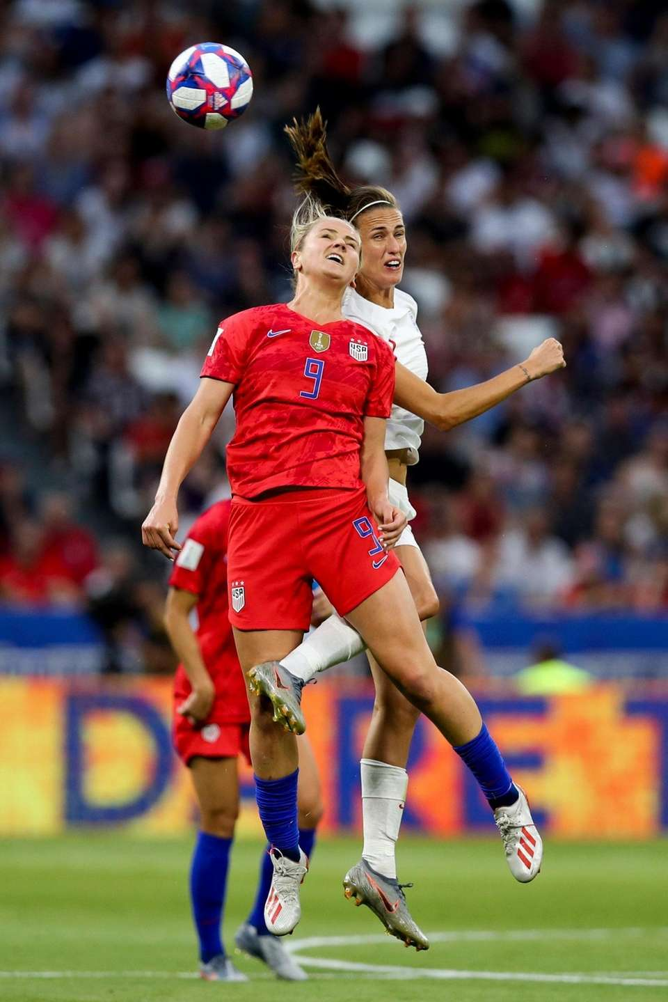 The United States' Lindsey Horan, foreground, jumps for