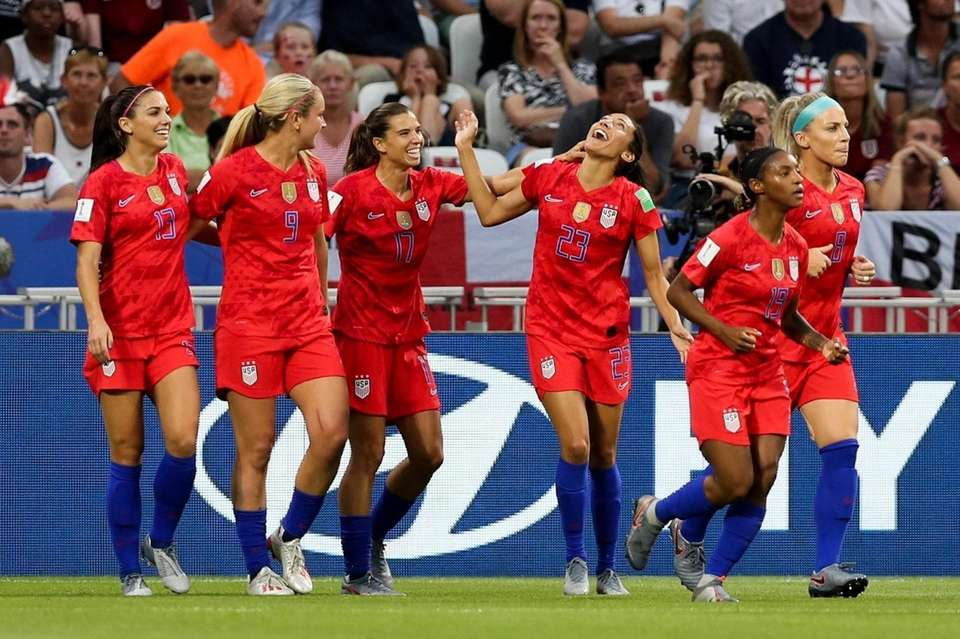United States players celebrate their opening goal against