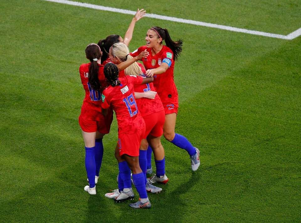 United States players celebrate their opening goal during