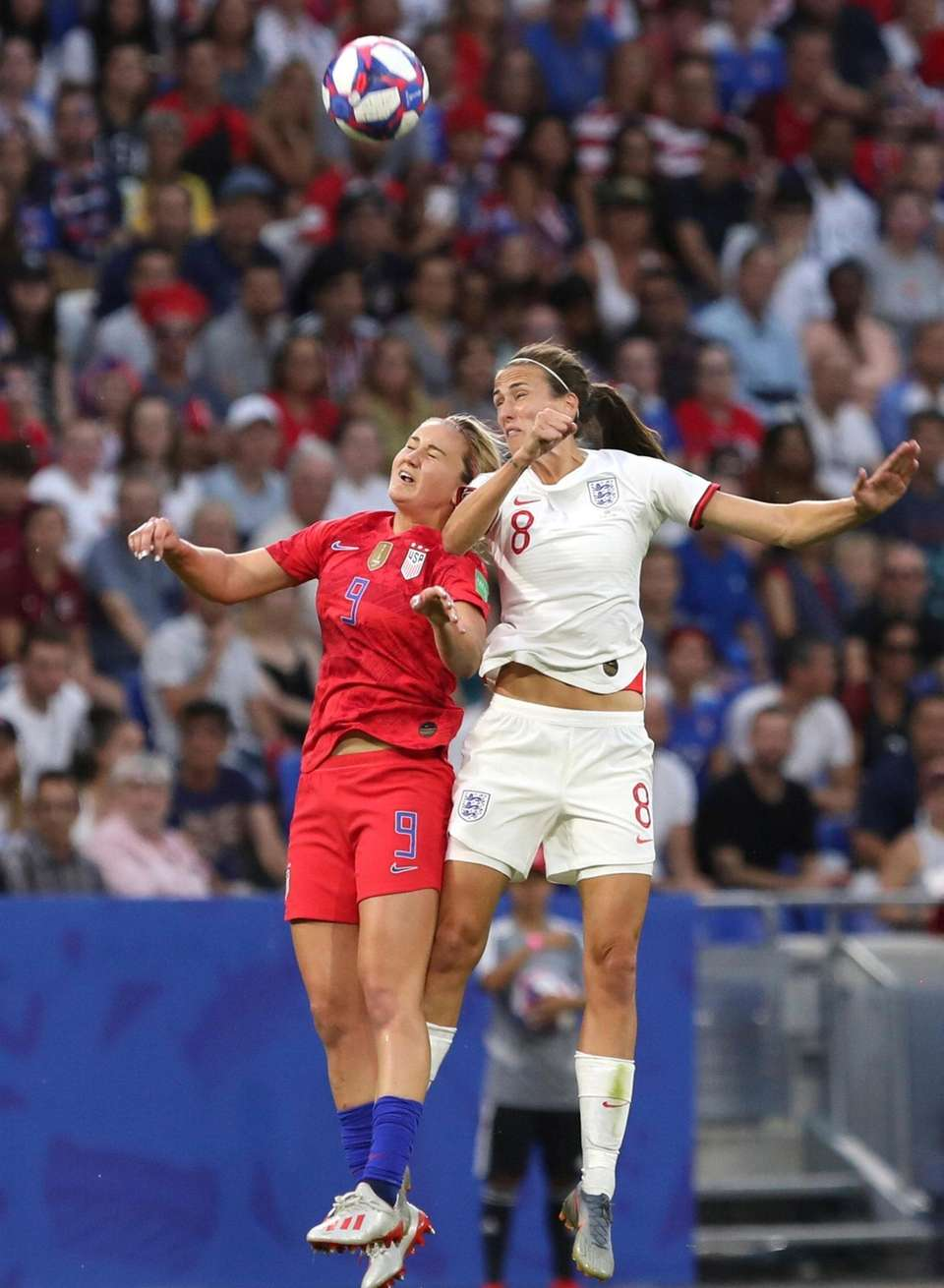 The United States' Lindsey Horan, left, and England's
