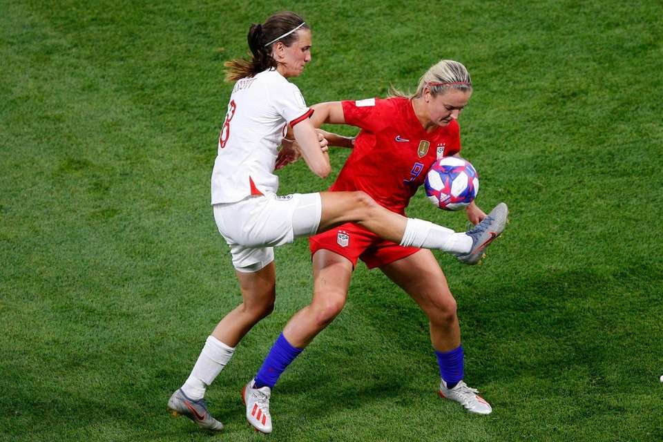 England's Jill Scott, left, and the United States'
