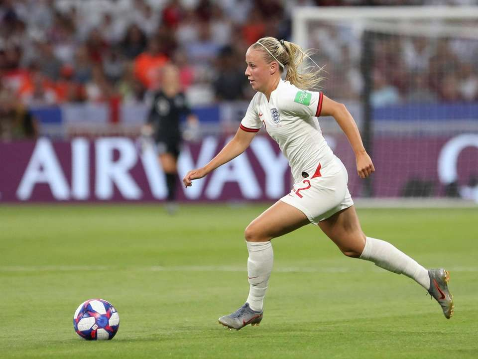 England's Beth Mead controls the ball during the