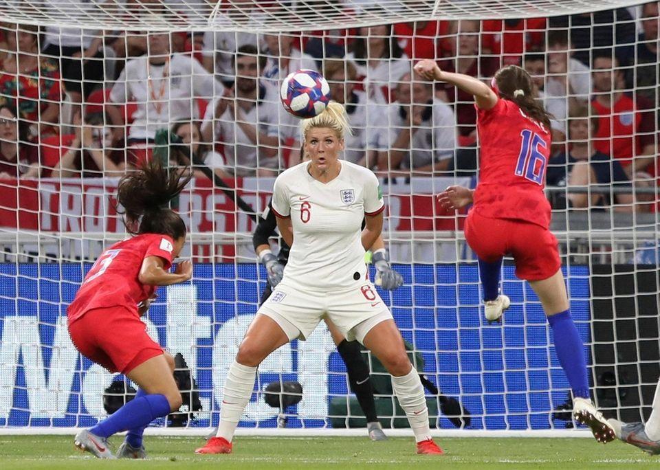 England's Millie Bright, centre, follows the ball ahead