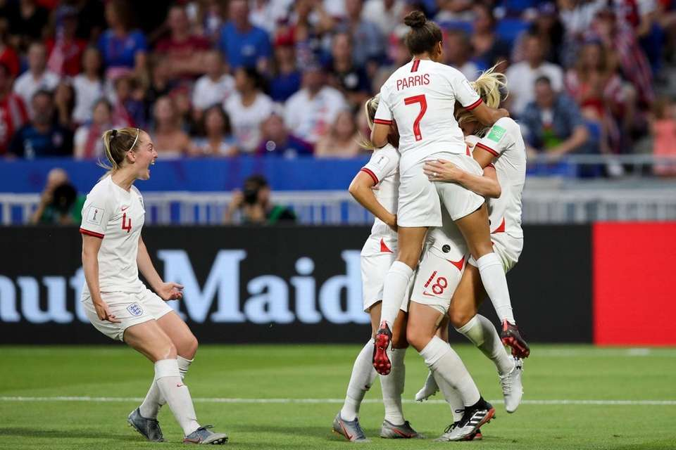 England players celebrate after scoring against United States