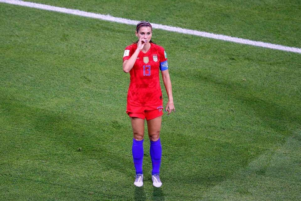 The United States' Alex Morgan celebrates her side's