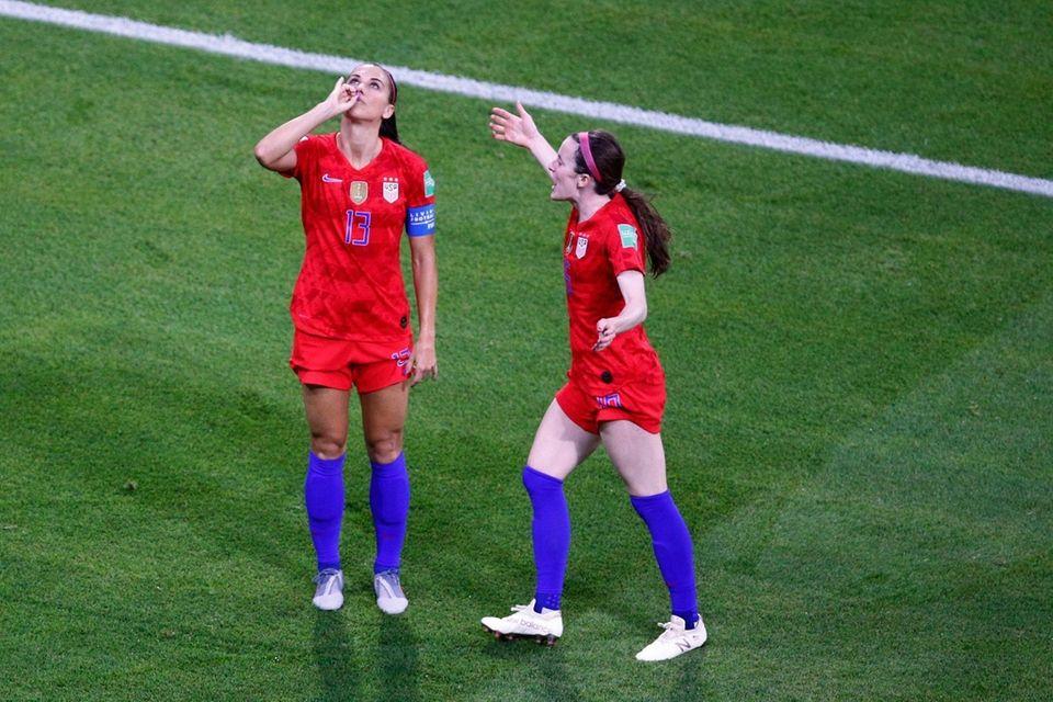 The United States' Alex Morgan, left, celebrates her
