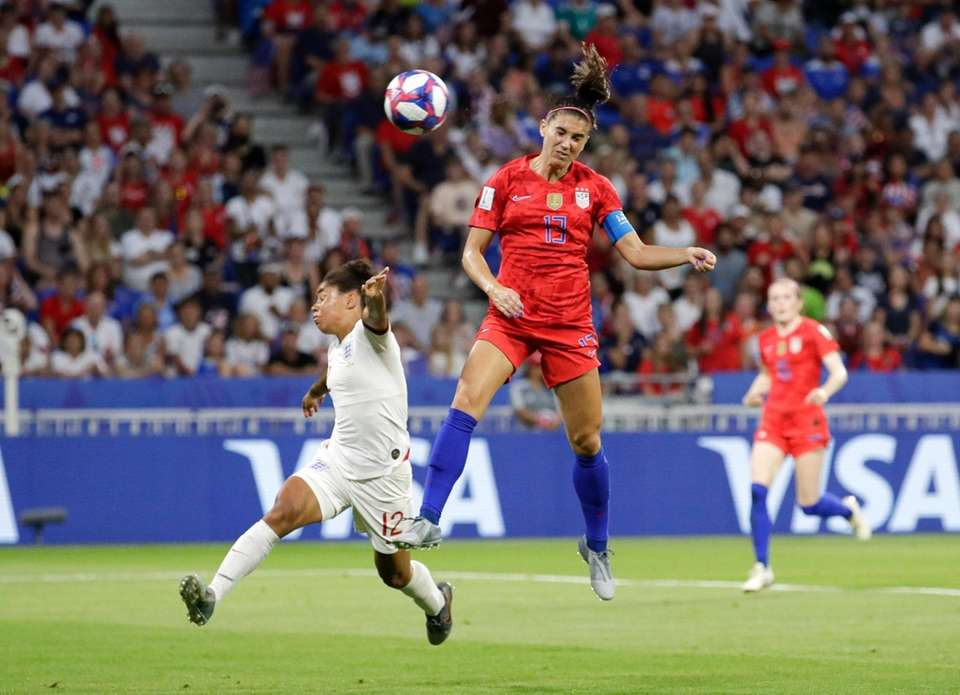 The United States' Alex Morgan, right, scores her