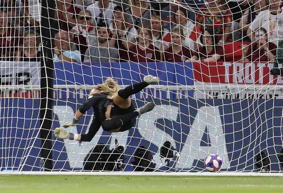 England goalkeeper Carly Telford dives but fails to