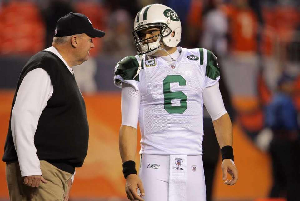 Head coach Rex Ryan and Mark Sanchez talk