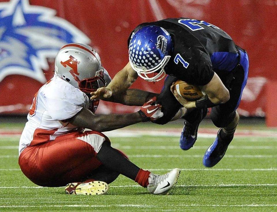 John Glenn quarterback Rich Czeczotka is tackled by