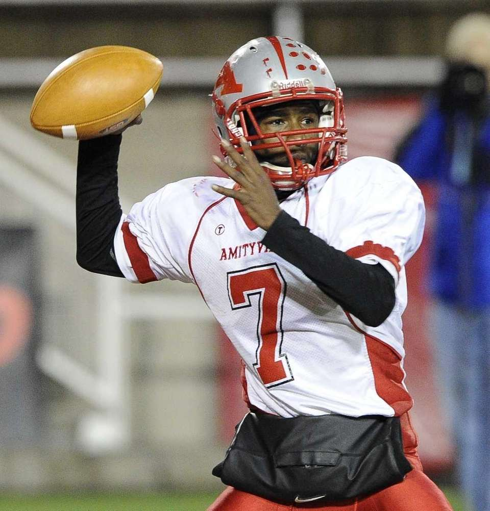 Amityville quarterback Sean Walters looks to pass against