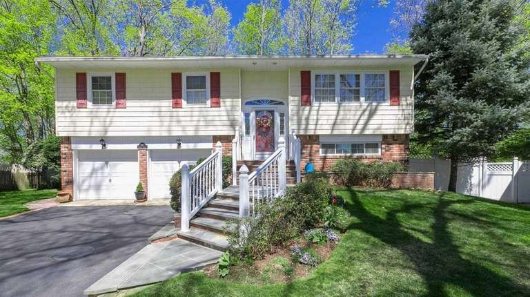 This East Norwich split-level is listed for $699,000.