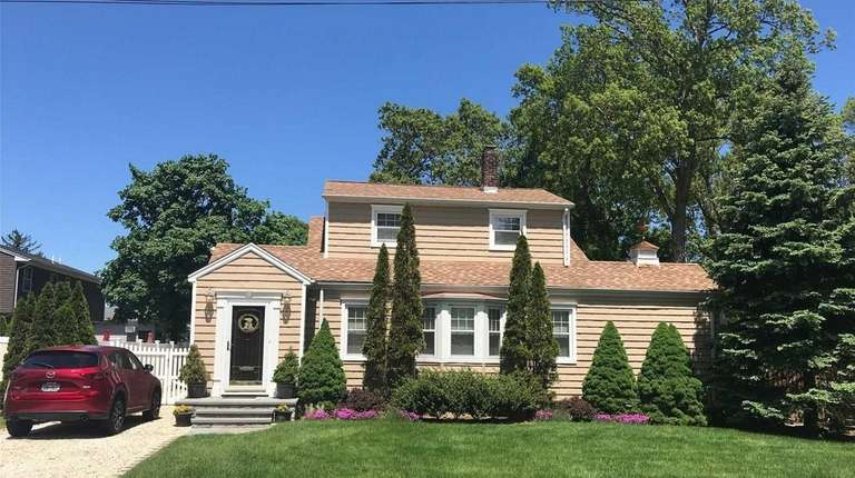 This East Norwich Colonial is listed for $589,000.