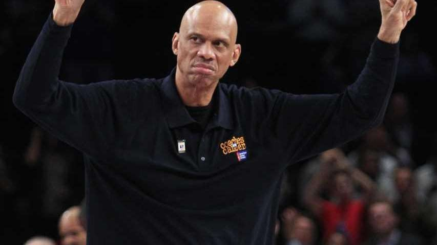 Former NBA player Kareem Abdul Jabbar gestures to