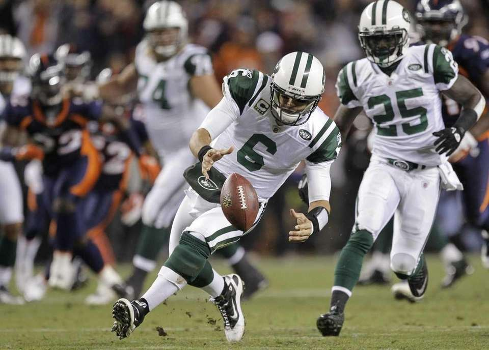 New York Jets quarterback Mark Sanchez (6) recovers