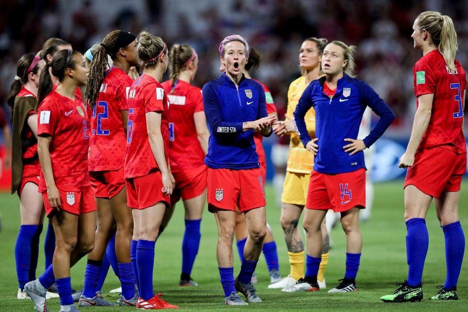 The United States' Megan Rapinoe, center, celebrates the